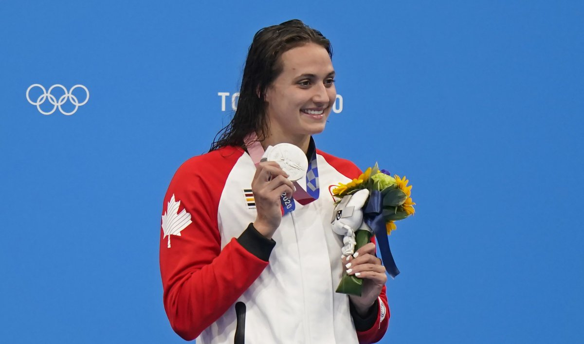 Canada's Kylie Masse celebrates a silver medal in the women's 200m backstroke final during the Tokyo Summer Olympic Games, in Tokyo, Saturday, July 31, 2021. THE CANADIAN PRESS/Adrian Wyld.