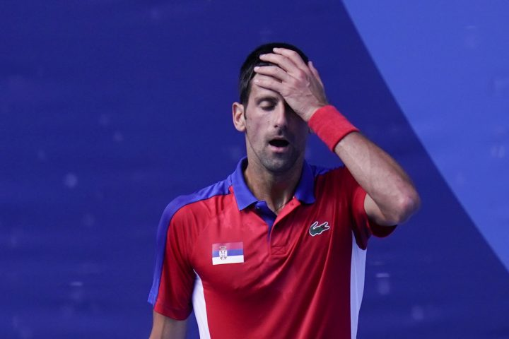 Novak Djokovic, of Serbia, reacts during the bronze medal match of the tennis competition against Pablo Carreno Busta, of Spain, at the 2020 Summer Olympics, Saturday, July 31, 2021, in Tokyo, Japan.