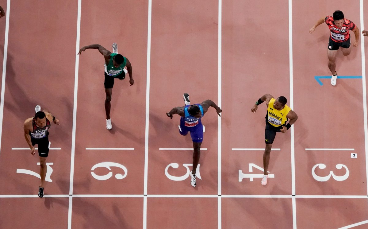 Andre De Grasse, of Canada, crosses the finish line ahead of Yohan Blake, of Jamaica, and Justin Gatlin, of the United States, in a men's 100 meter semifinal at the World Athletics Championships in Doha, Qatar, Saturday, Sept. 28, 2019. (AP Photo/Morry Gash).