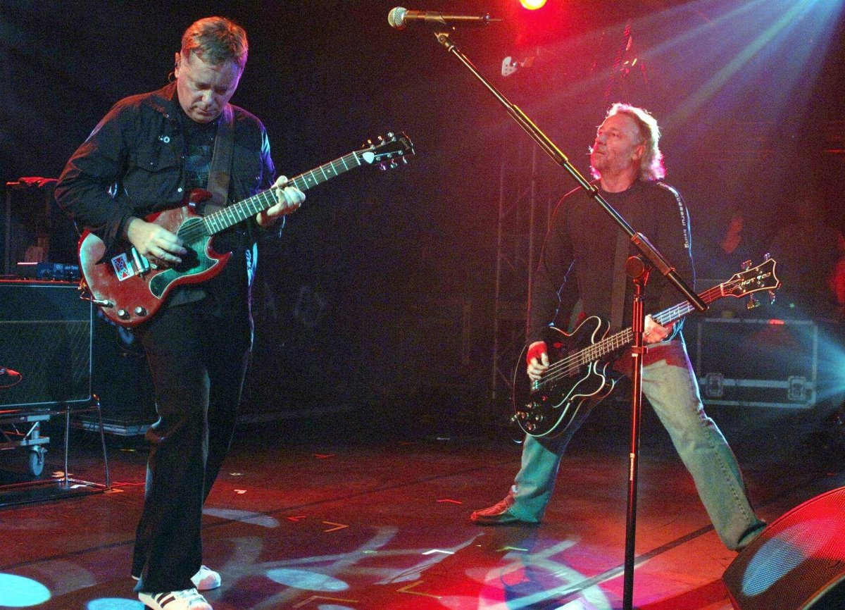 New Order perform onstage in 2005. If you had gone to the show, would you have worn the band's T-shirt?.