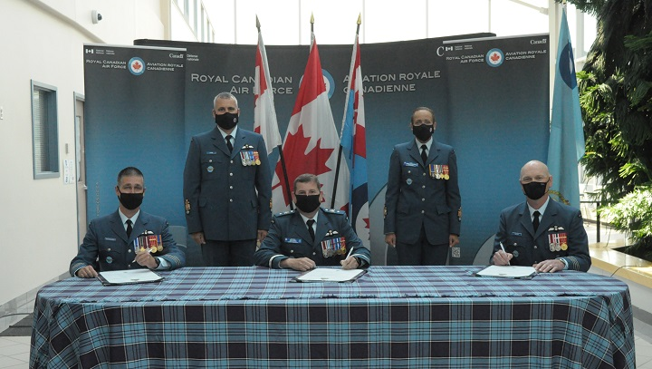 Col. C.Y. Jonathan Bouchard (bottom left) is the new wing commander of 15 Wing Moose Jaw after Col. Ron J. Walker (bottom right) relinquished the role on July 15.