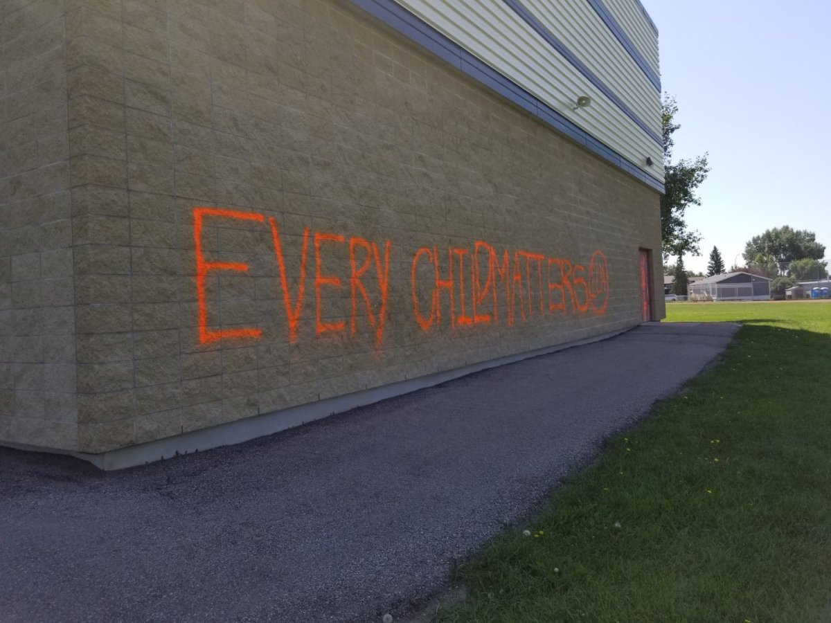"""""""Every child matters"""" is spray painted on the side of Muriel Clayton School in Airdrie, Alta, in an undated photo. RCMP are looking for help identifying who is responsible."""