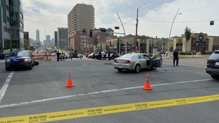 Police respond to what appears to be a crash at Jasper Avenue and 109 Street in Edmonton on Friday.