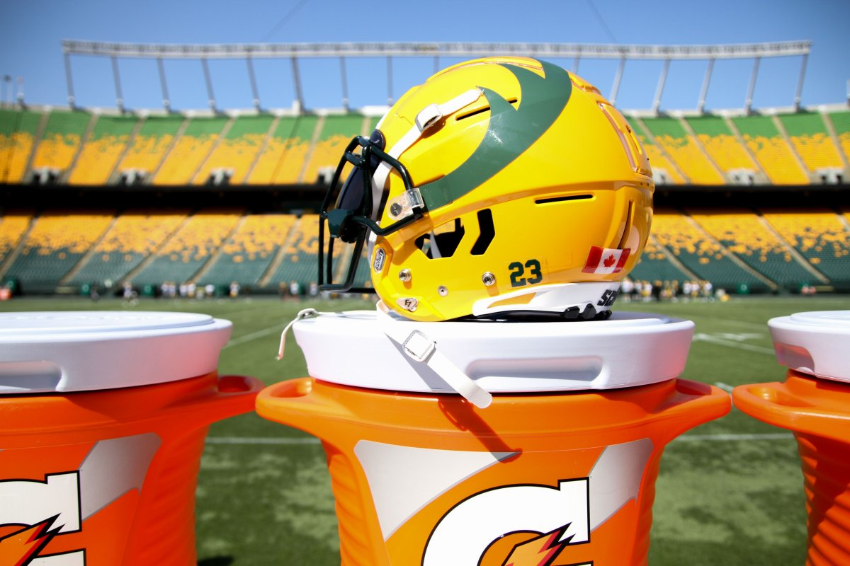 Edmonton Elks helmet with Commonwealth Stadium in the background.