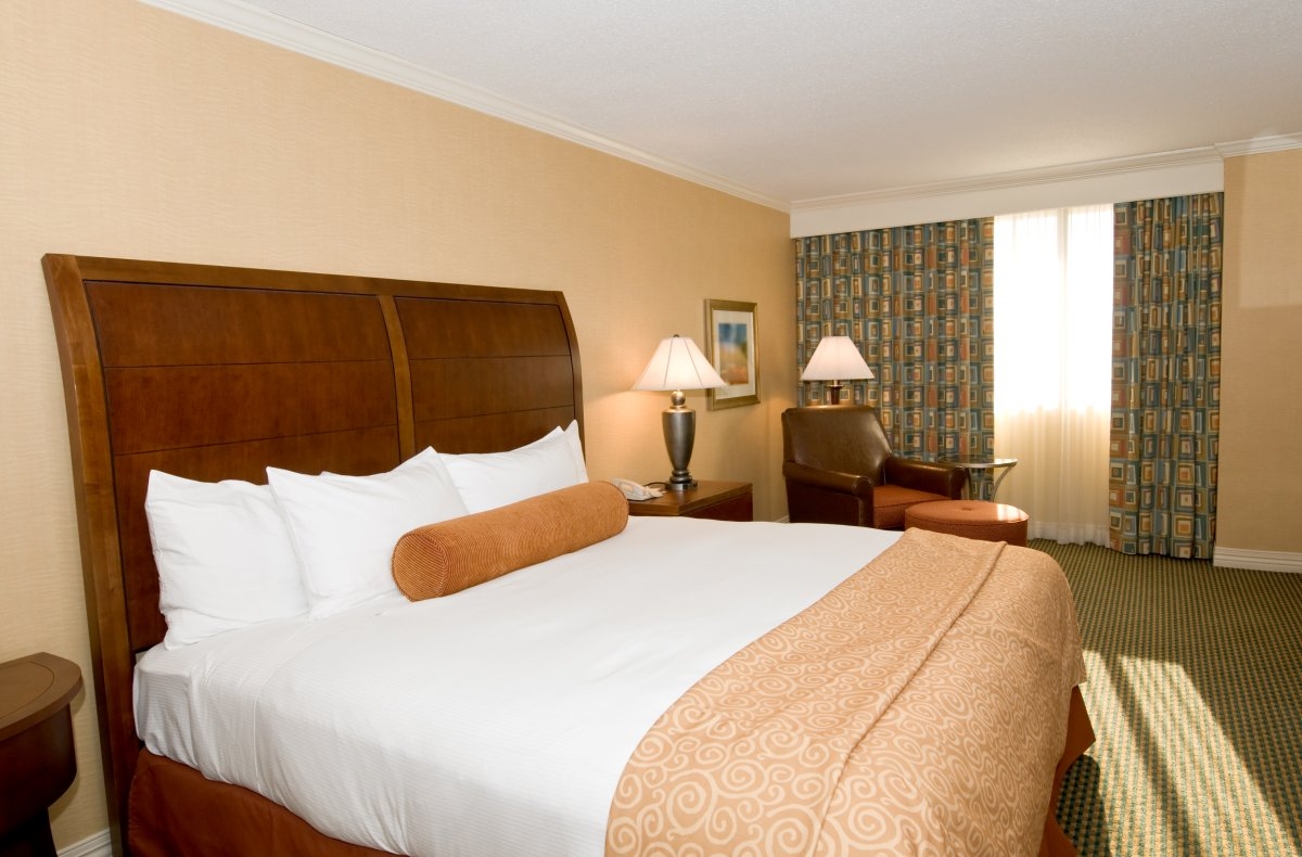 FILE - Hotel room with queen bed.