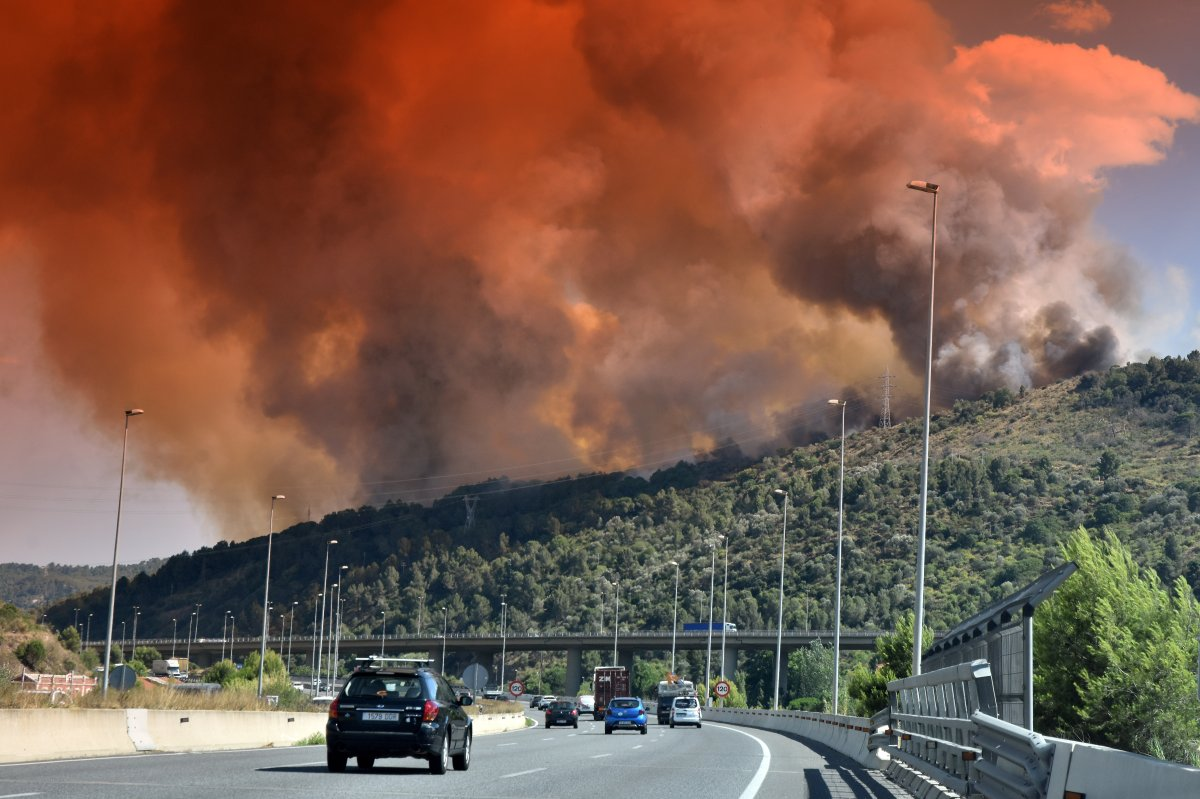A cloud of smoke and fire in Castellvi de Rosanes seen over A-2 highway in Martorell during the fire.