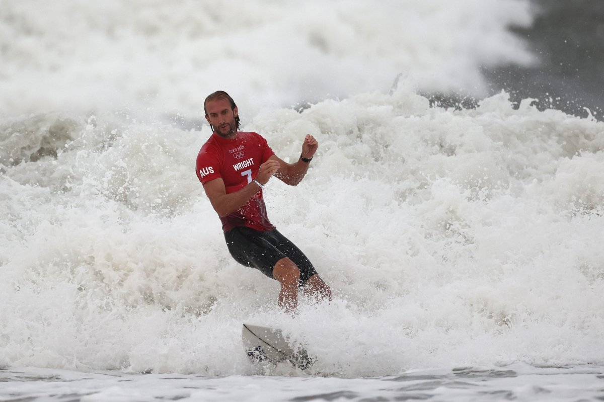 Owen Wright of Team Australia shows emotion after riding a wave during his men's round 3 heat on day three of the Tokyo 2020 Olympic Games at Tsurigasaki Surfing Beach on July 26, 2021 in Ichinomiya, Chiba, Japan.