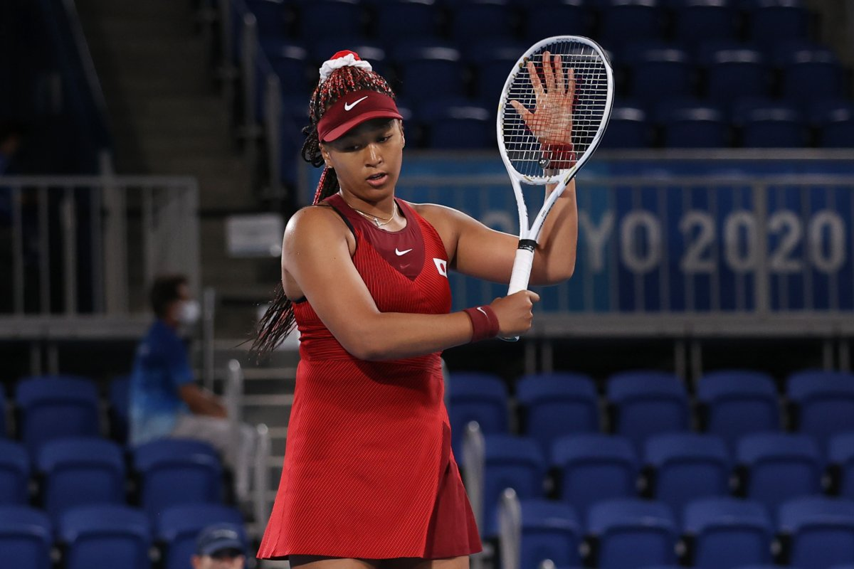 Naomi Osaka of Team Japan reacts after a point during her Women's Singles Third Round match against Marketa Vondrousova of Team Czech Republic on day four of the Tokyo 2020 Olympic Games at Ariake Tennis Park on July 27, 2021 in Tokyo, Japan.