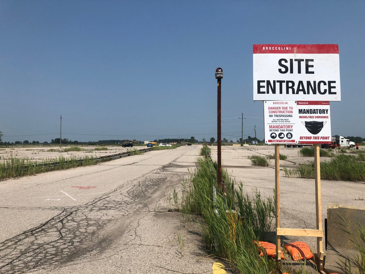 A sign marks the entrance to a Broccolini construction site at the land of a former Ford assembly plant in Talbotville, Ont. on July 5.