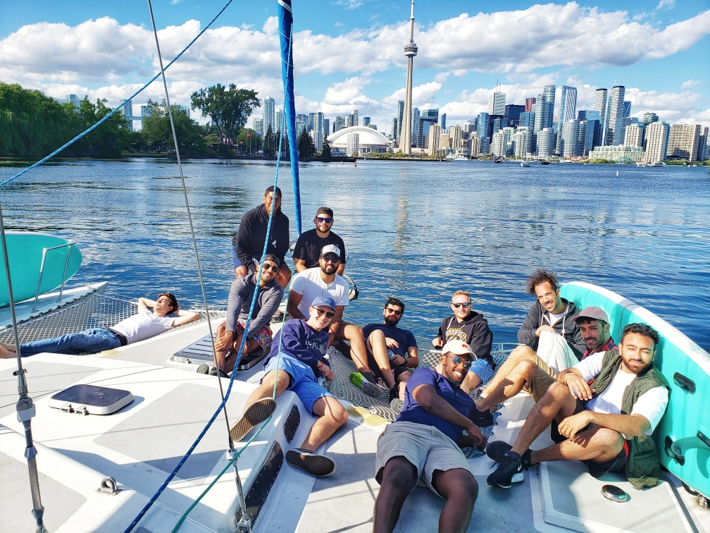 Lazer Technologies employees pose with Toronto's CN Tower in the background