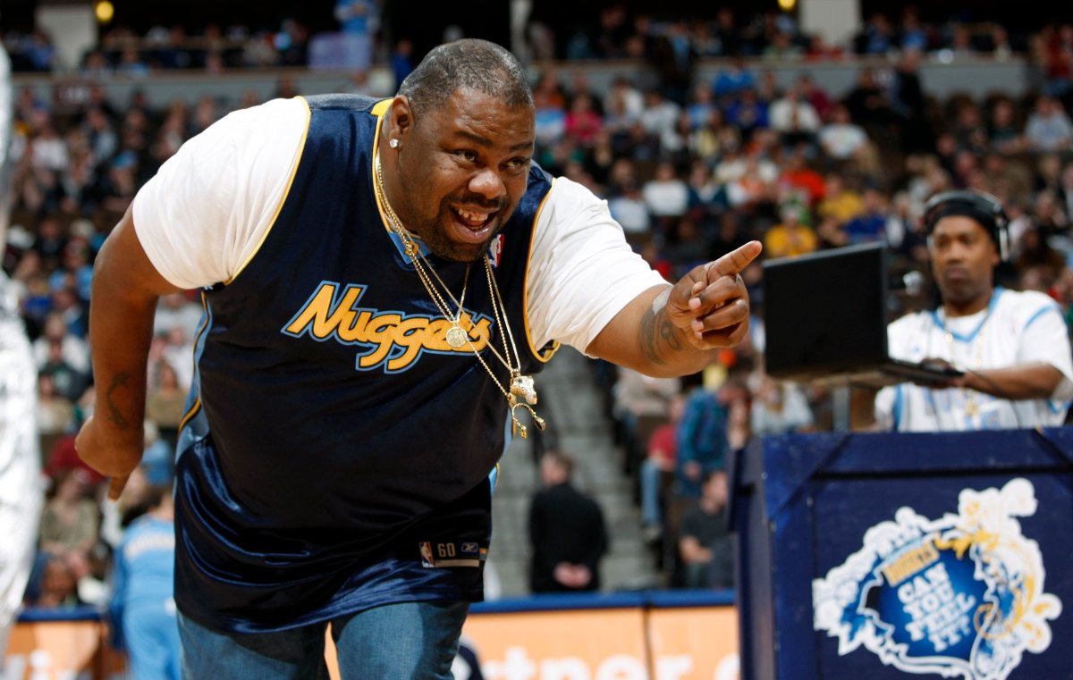 """Biz Markie performs for fans during halftime of the Denver Nuggets' 105-99 victory over the Phoenix Suns in an NBA basketball game in Denver on Dec. 12, 2009. The hip-hop staple known for his beatboxing prowess, turntable mastery and the 1989 classic """"Just a Friend,"""" has died. He was 57. Markie's representative, Jenni Izumi, said in a statement that the rapper-DJ died peacefully Friday, July 16, 2021, with his wife by his side. No cause of death was released. (AP Photo/David Zalubowski)."""
