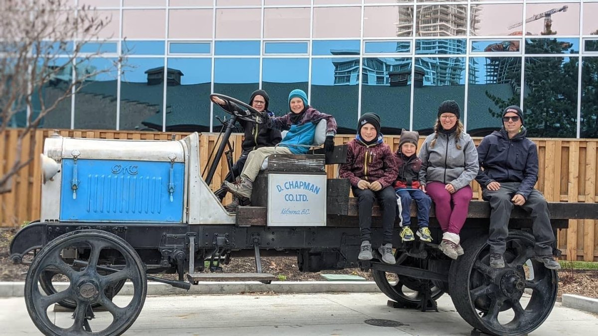 Vicky Ringuette and Alexandre Lessard with their four sons shown on an antique vehicle during a stop on their travels. The family of six has been travelling for the past eight months across Canada.