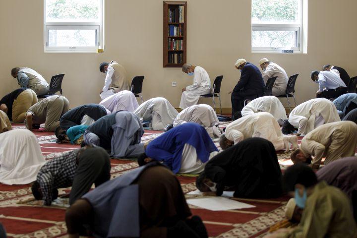 Men pray at the Hamilton Mountain Mosque during Eid al-Adha in Hamilton, Ont., Tuesday, July 20, 2021.