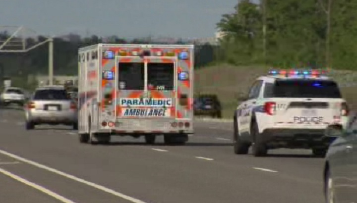 Peel Paramedics take a patient to a hospital with a police escort Friday afternoon.