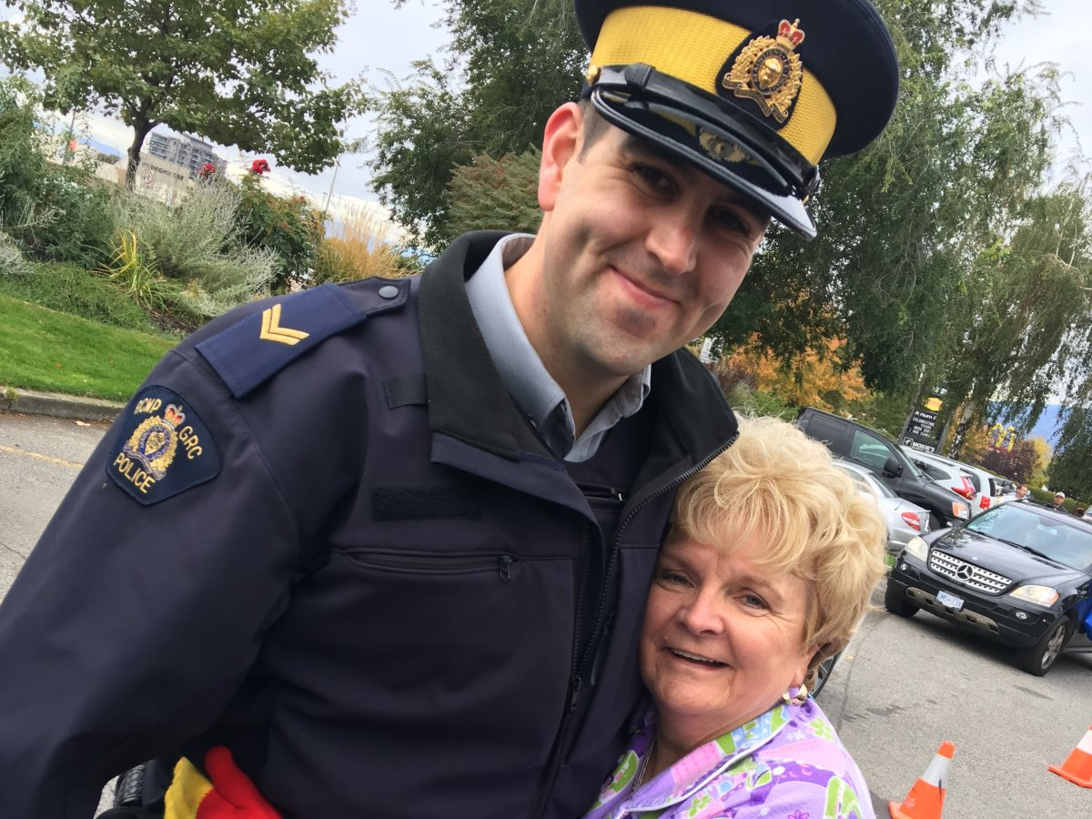 Cpl. Jesse O'Donaghey, seen here getting a hug from Kelowna city councilor Maxine DeHart during a charitable fundraiser.