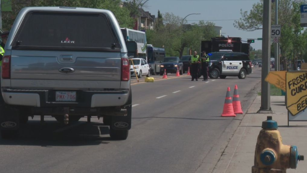 Edmonton police investigate a serious collision involving a pedestrian on Whyte Avenue, Wednesday, July 7, 2021.