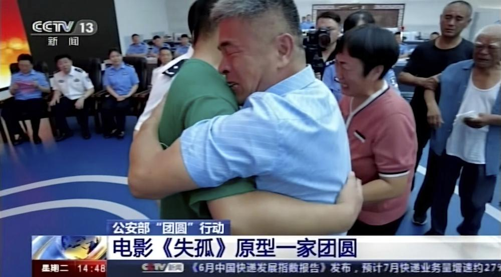 In this image taken from a video footage run by China's CCTV via AP Video, Guo Gangtang at right embraces his long lost son Guo Xinzhen during a reunion after 24 years in Liaocheng in Central China's Shandong province on Sunday, July 11, 2021. Guo was abducted as a toddler outside their home.