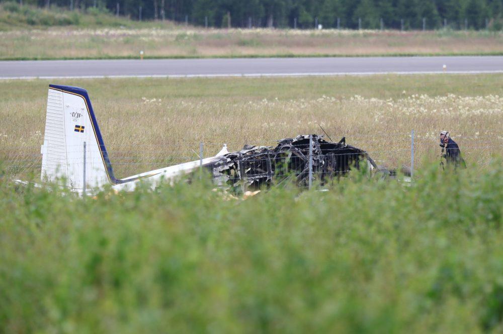 Police investigate the site of a plane crash near Orebro, Sweden, on July 9, 2021.