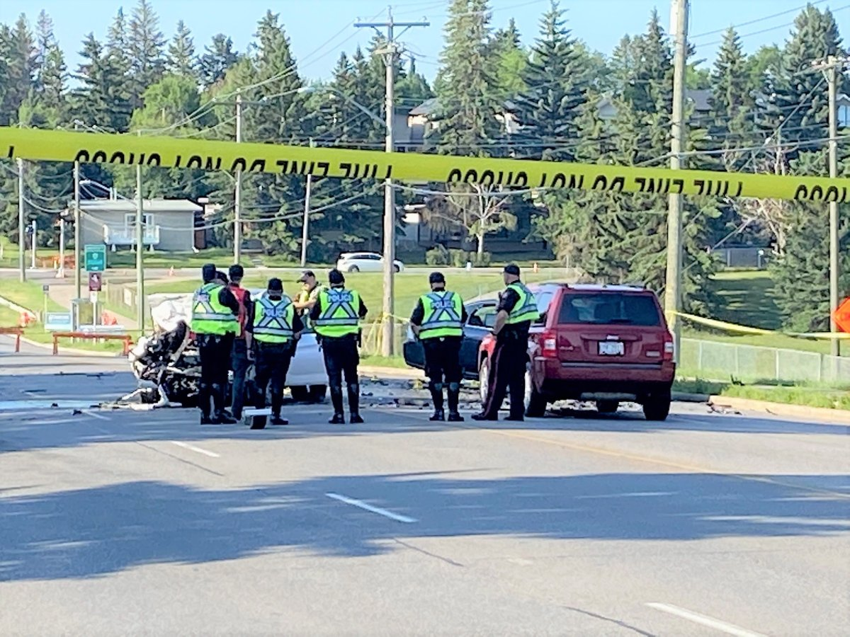 Calgary police investigate a fatal two-vehicle crash on 14 Street Northwest on Friday, July 9, 2021.