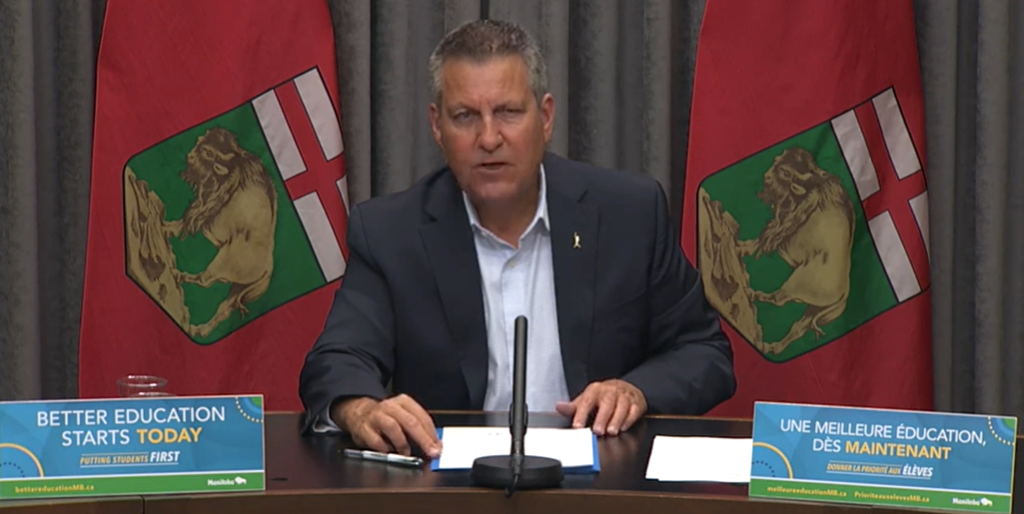 Education Minister Cliff Cullen speaks to media Wednesday.