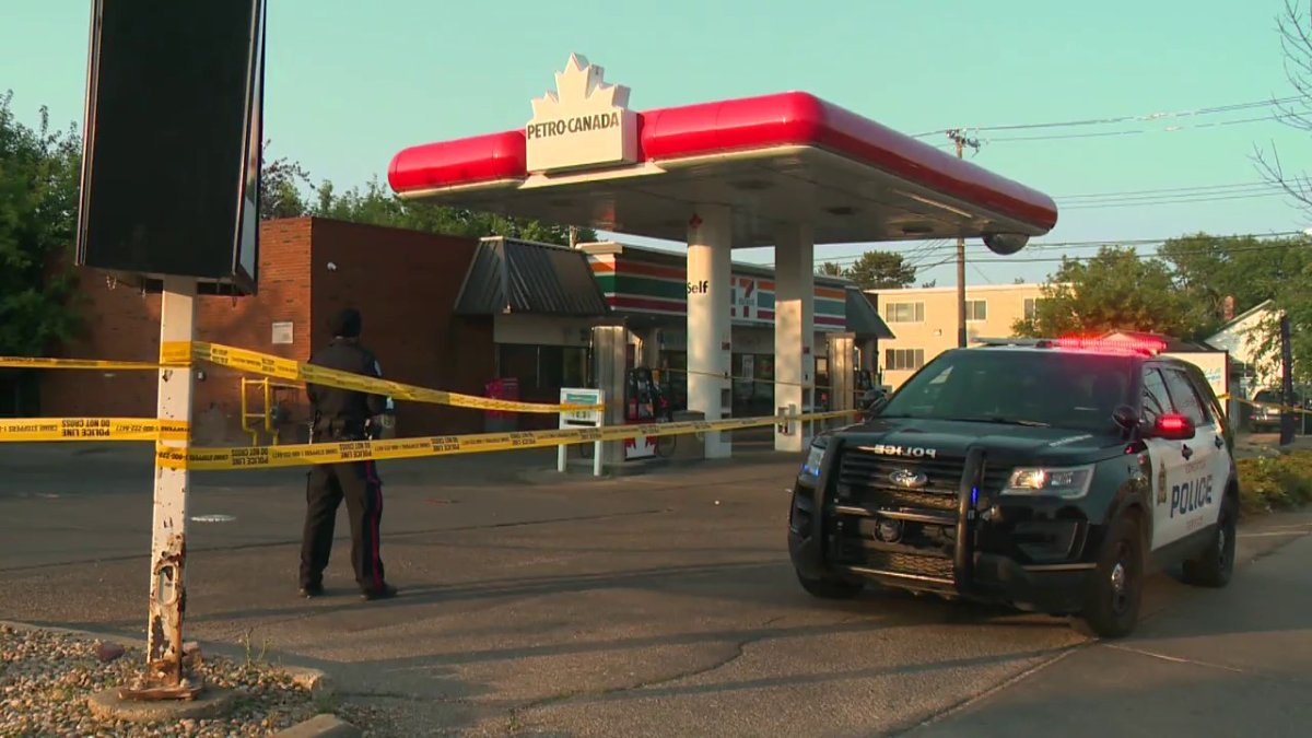 The Edmonton Police Service investigates a suspicious death outside a convenience store in the area of 107 Avenue and 115 Street Monday, July 12, 2021.