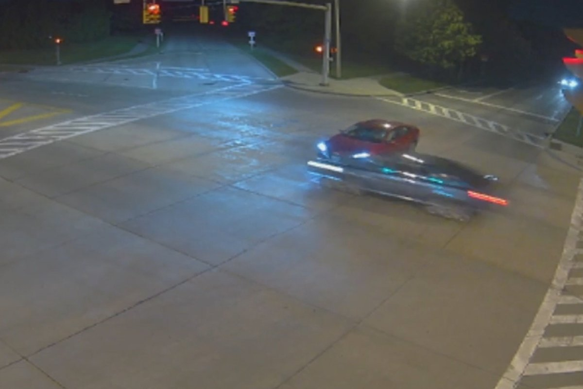 A vehicle, right, runs through an intersection in front of another car just before midnight on June 15 in Beachwood, Ohio, in this image from traffic cam video.