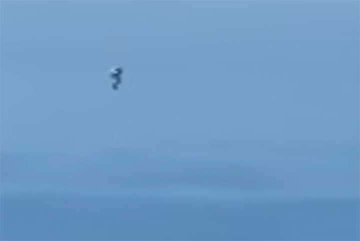 This image from video posted Dec. 23, 2020, shows an object flying through the air off the coast of California.