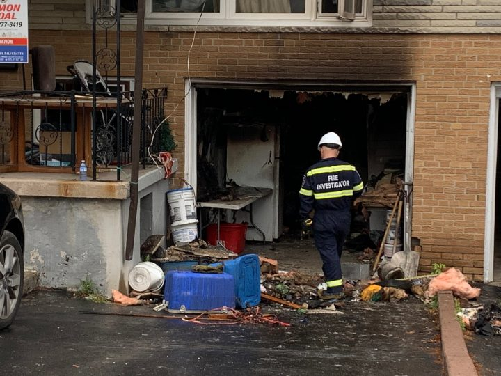 A fire investigator at the scene of a house fire in Mississauga on Saturday.