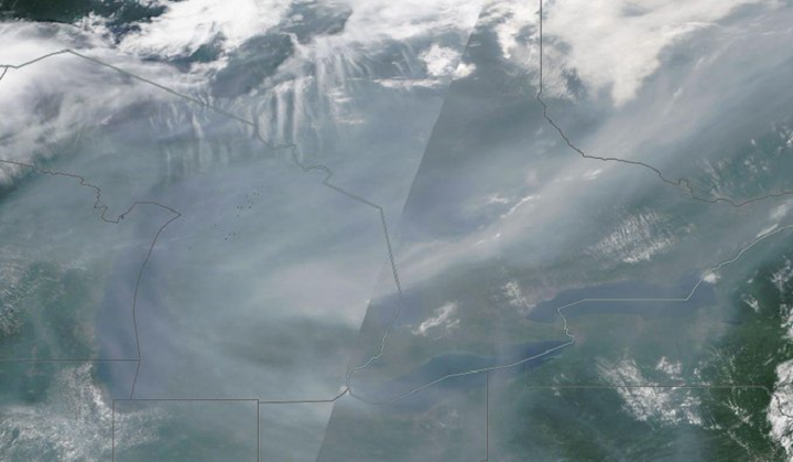 Smoke is seen over the Great Lakes.