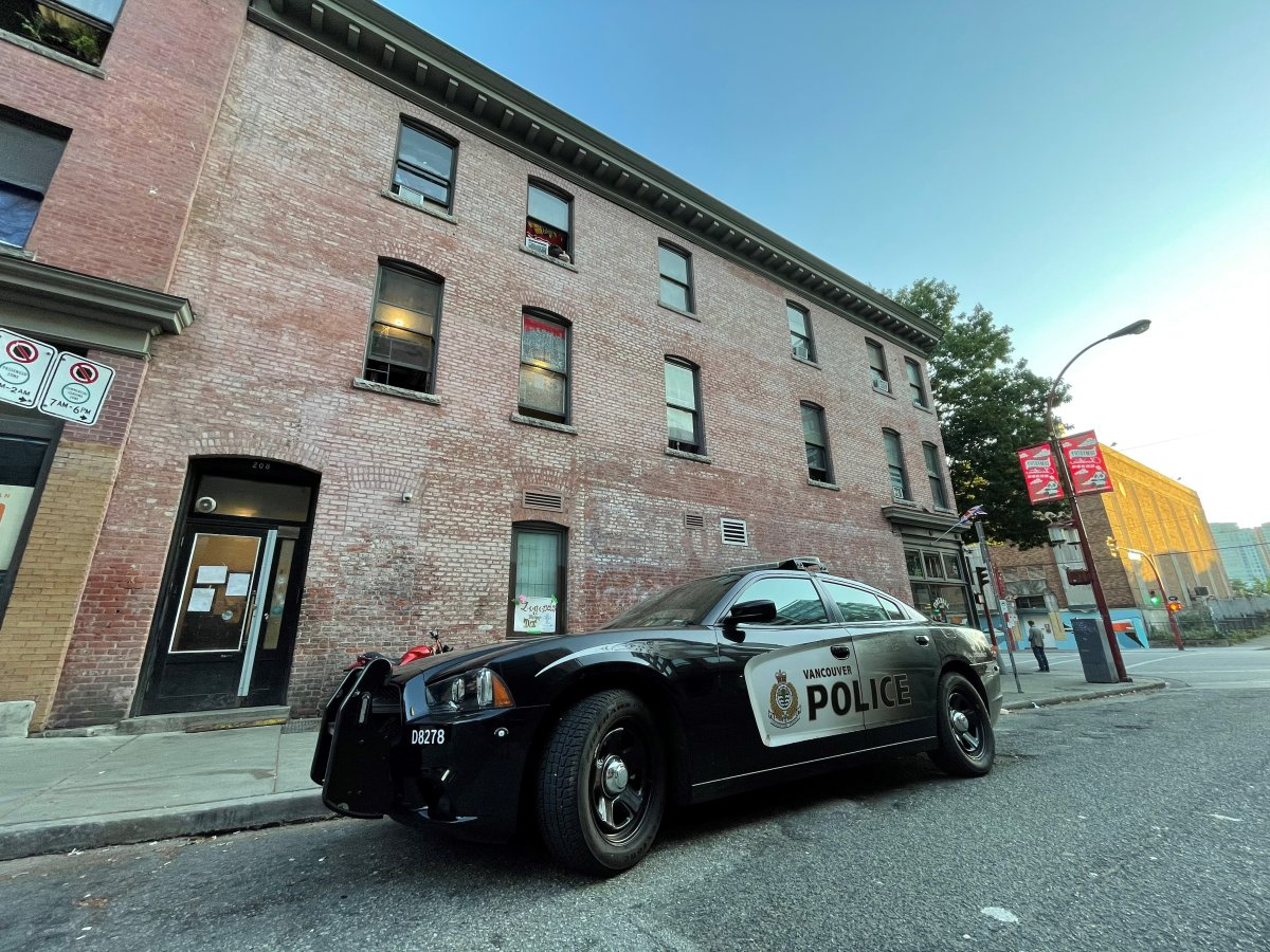 Vancouver police outside the London Hotel in the Strathcona neighbourhood of Vancouver on July 20, 2021. Police are investigating a fatal shooting that occurred inside the hotel Tuesday morning.
