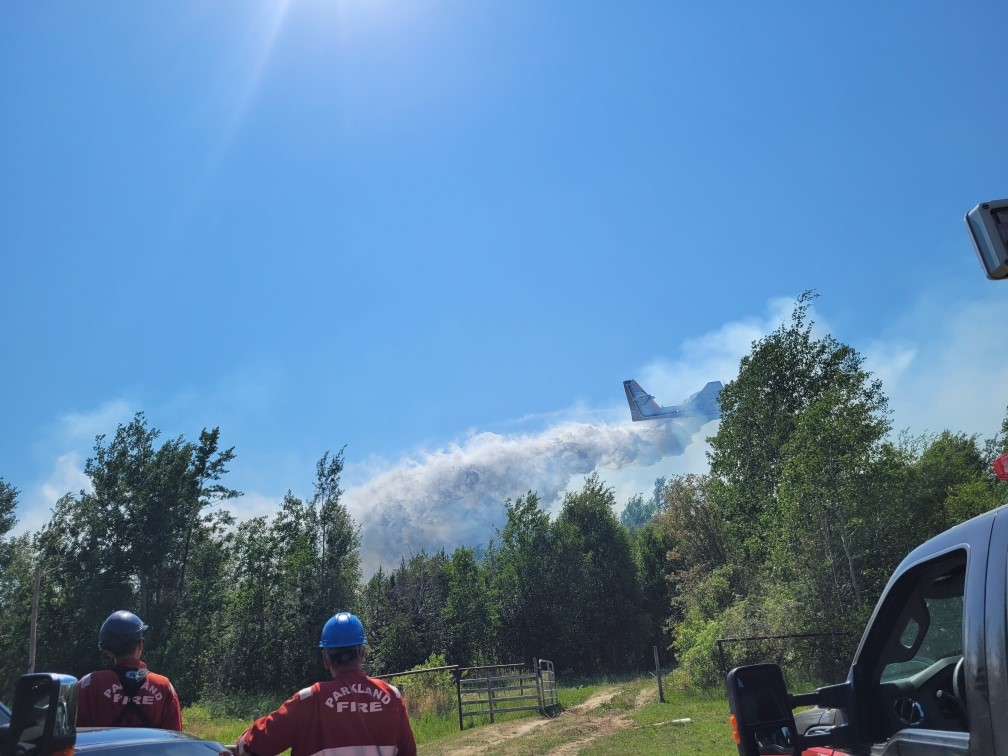 Water bombers over Tanya Dirk's property on July 1 in Tomahawk.