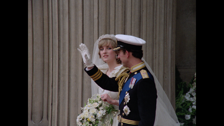 Princess Diana and Prince Charles wave to the crowd at their wedding.