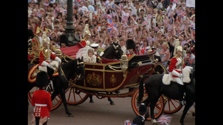 Princess Diana and Prince Charles wave to crowds after their wedding.