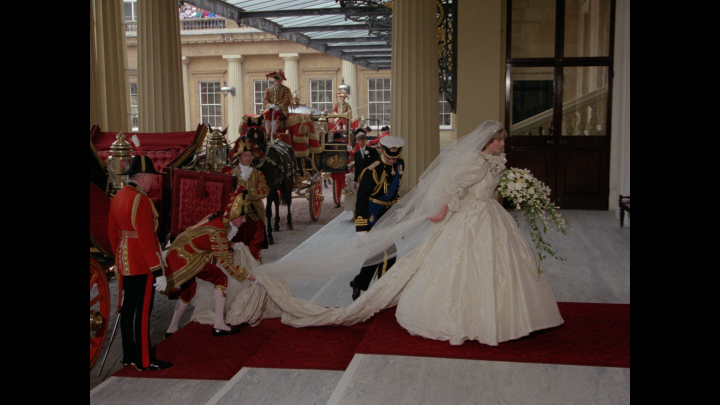 Princess Diana emerges in her wedding gown before the ceremony.