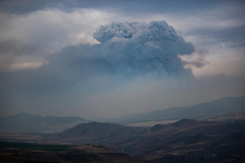 A pyrocumulus cloud, also known as a fire cloud, forms in the sky as the Tremont Creek wildfire burns on the mountains above Ashcroft, B.C., on July 16, 2021. THE CANADIAN PRESS/Darryl Dyck.