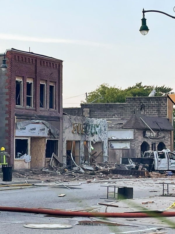 Damaged buildings across the street from the scene of the explosion in Wheatley, Ont., Aug. 26, 2021