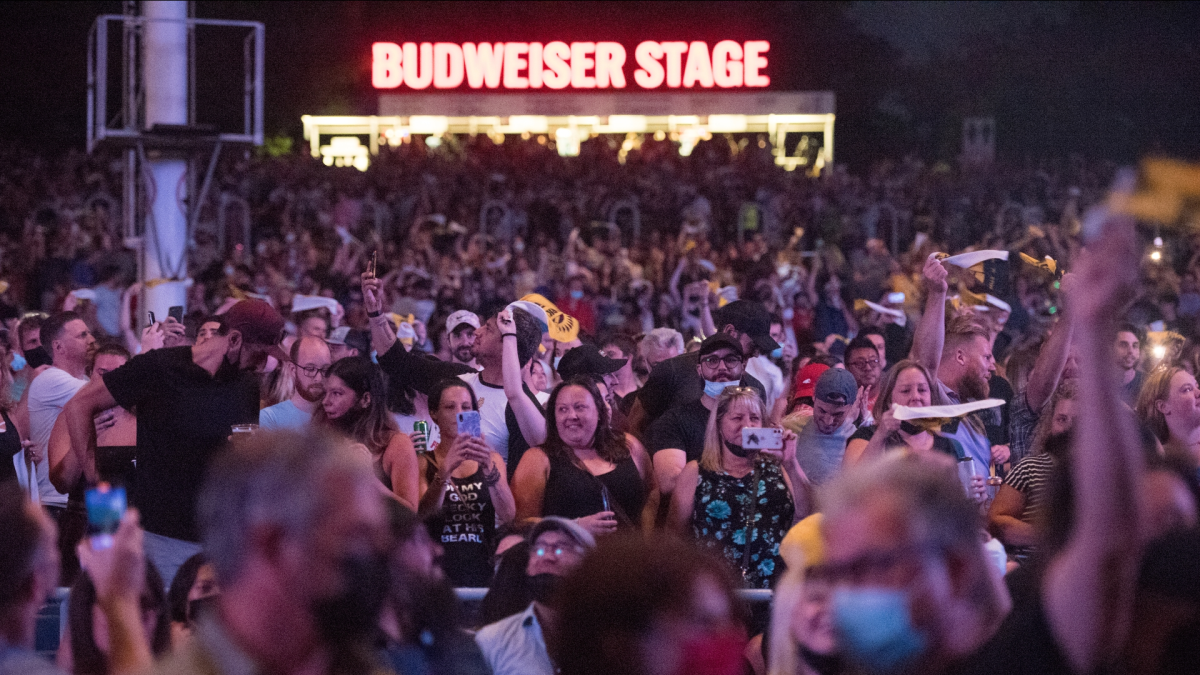 People cheer the Arkells on stage during their first live performance since the pandemic restrictions lifted, at the Budweiser Stage in Toronto on Friday, August 13, 2021. The concert marked the first live event for the band since the pandemic.