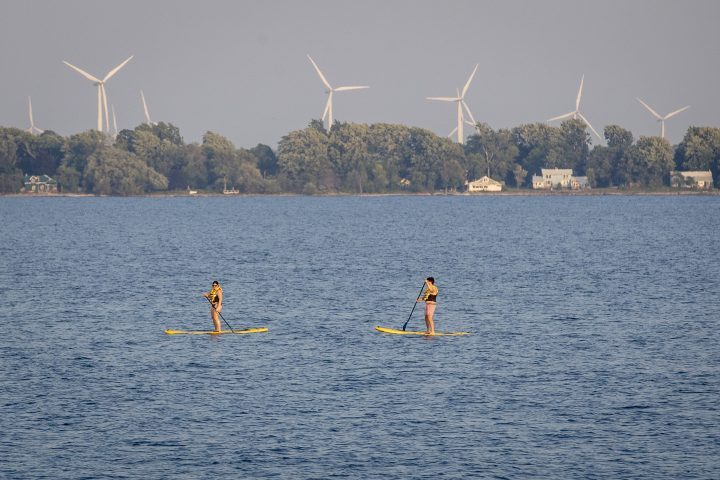 People paddle board in Lake Ontario during a warm and humid day in Kingston, Ontario on Tuesday July 6, 2021.