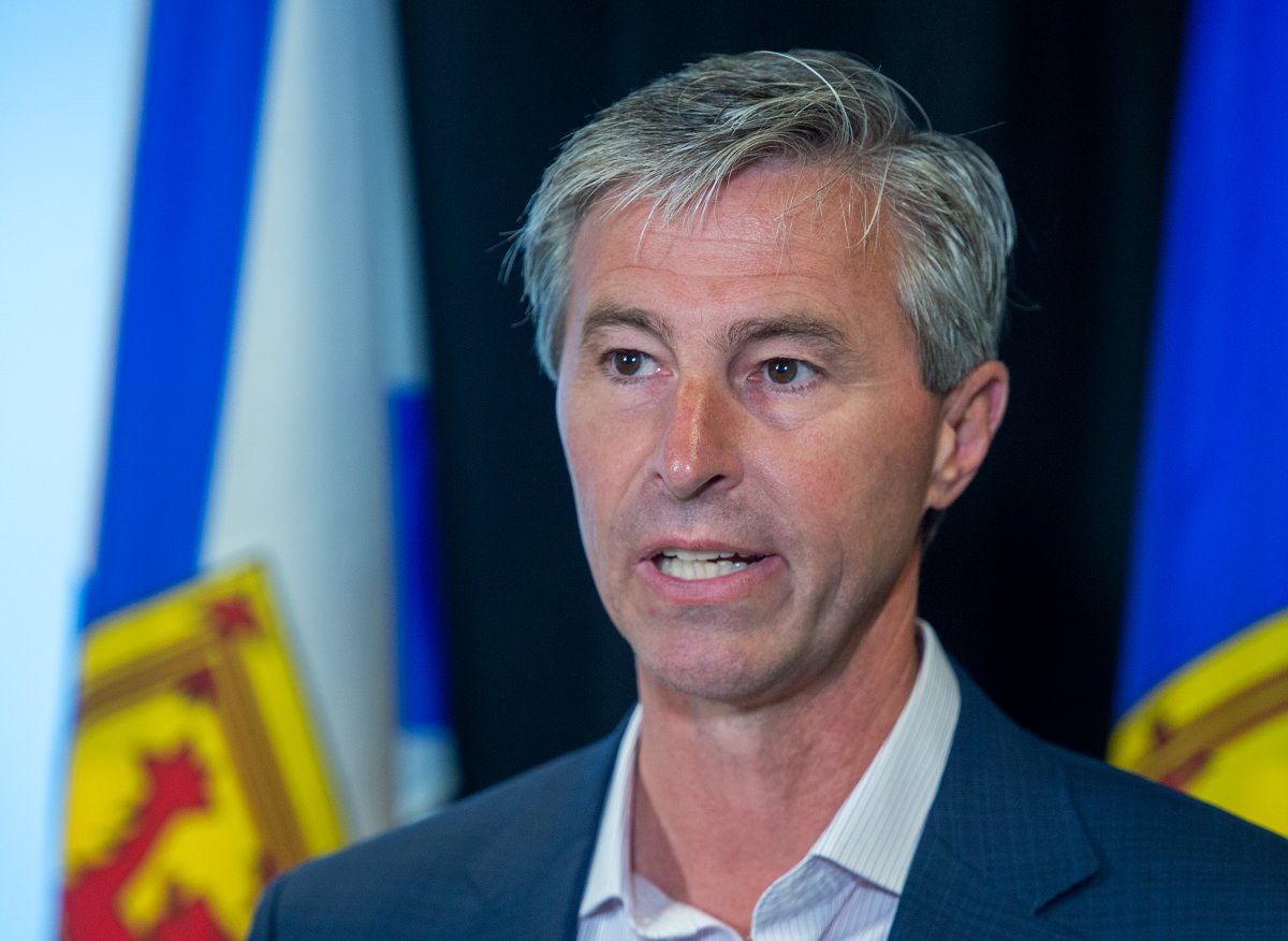 Nova Scotia Progressive Conservative leader Tim Houston announces a program that would reward shoppers for by participating local products at a campaign event in Halifax on Tuesday, July 20, 2021.