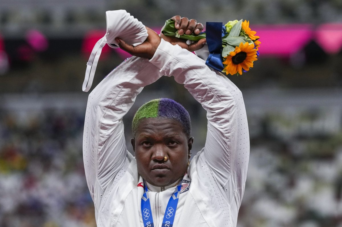 """Raven Saunders, of the United States, poses with her silver medal on women's shot put at the 2020 Summer Olympics, Sunday, Aug. 1, 2021, in Tokyo, Japan.  During the photo op at her medals ceremony Sunday night, Saunders stepped off the podium, lifted her arms above her head and formed an """"X' with her wrists. Asked what that meant, she explained: """"It's the intersection of where all people who are oppressed meet."""" (AP Photo/Francisco Seco)."""