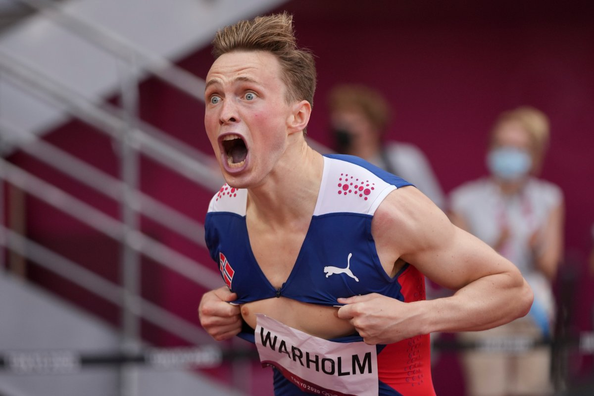 Karsten Warholm, of Norway, celebrates after winning the gold medal in the men's 400-meter hurdles at the 2020 Summer Olympics, Tuesday, Aug. 3, 2021, in Tokyo.(AP Photo/David J. Phillip).