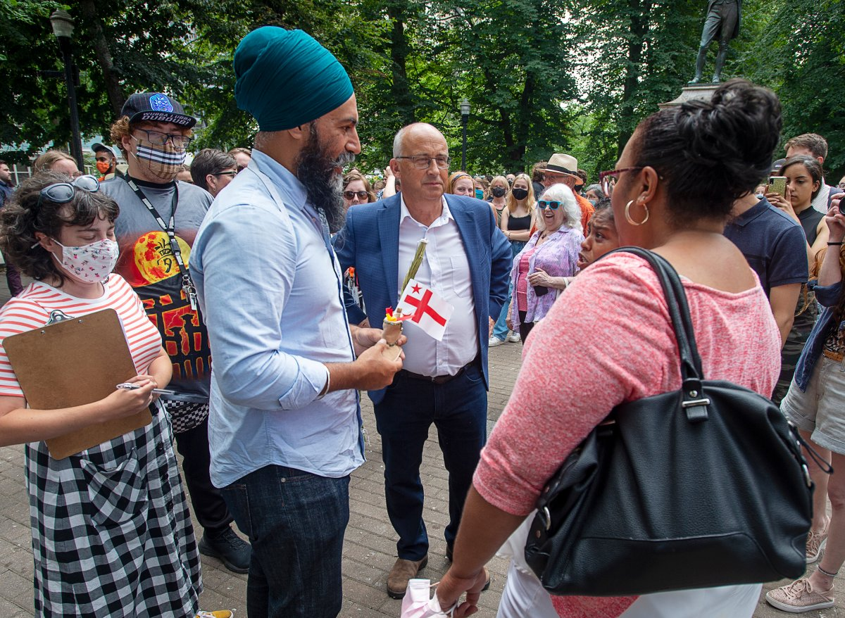 Federal NDP Leader Jagmeet Singh, left, and Nova Scotia NDP Leader Gary Burrill, centre, greet provincial candidates in Halifax on Wednesday, Aug. 11, 2021.