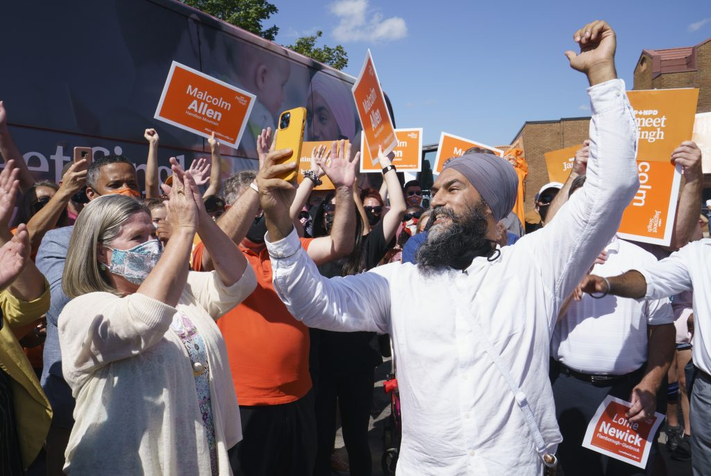 NDP leader Jagmeet Singh records a video for social media and is applauded by Ontario NDP leader Andrea Horwath during a campaign stop in Hamilton, Ont., on Tuesday, August 24, 2021. THE CANADIAN PRESS/Paul Chiasson.