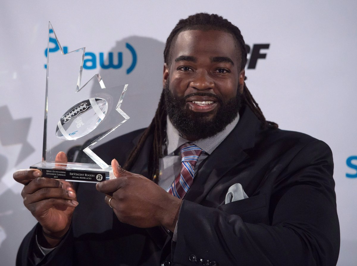 SirVincent Rogers poses for photographs after winning the CFL's most outstanding offensive lineman award during the Canadian Football League awards in Winnipeg on Thursday November 26, 2015.