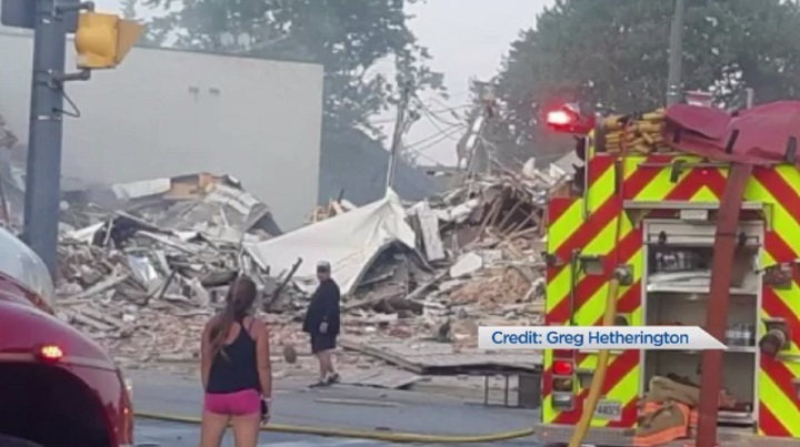 A heavily damaged building can be seen in Wheatley, Ont.