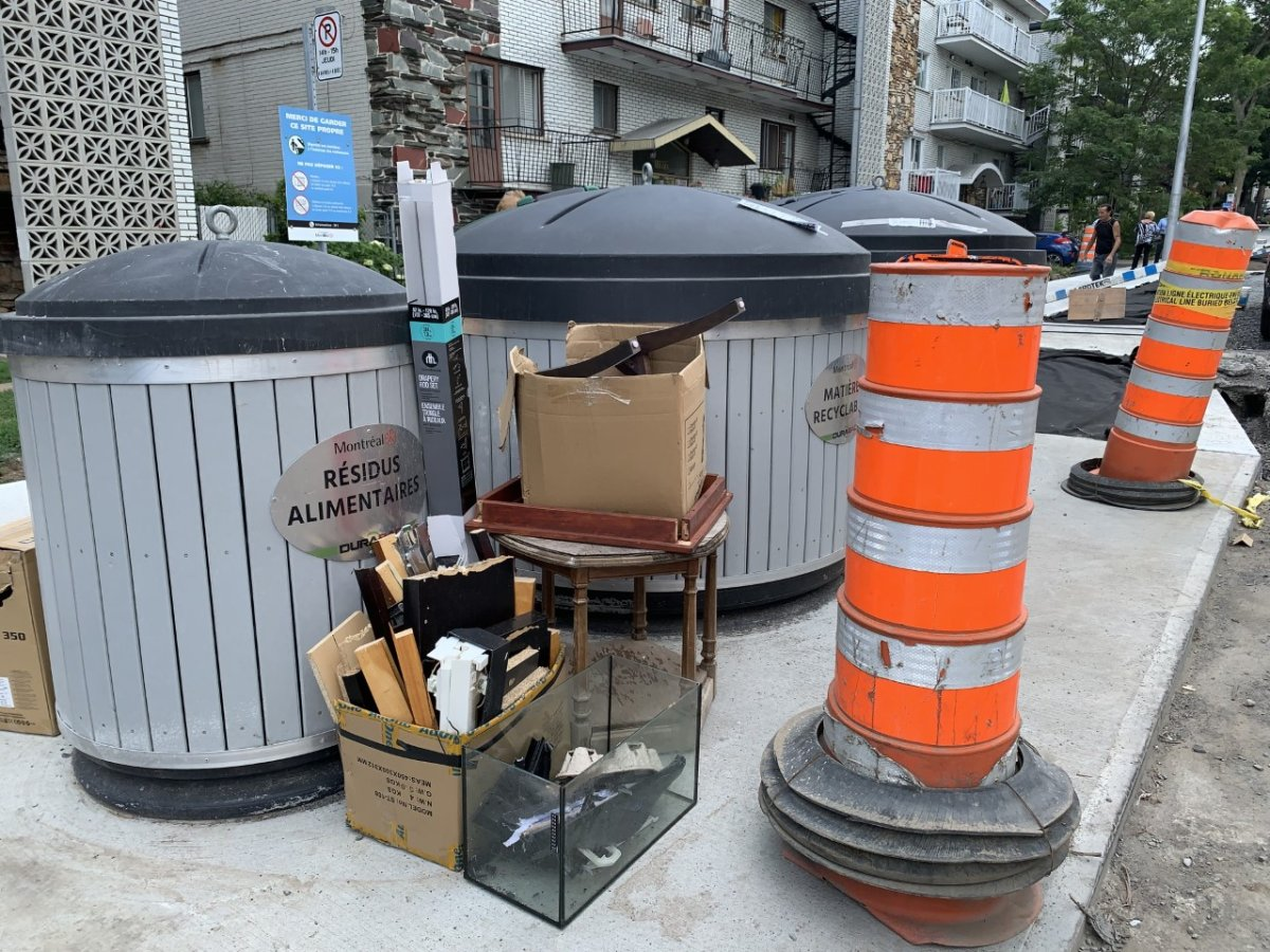 Waste piled up outside of garbage bins installed on Jubenville Avenue as part of a pilot project in Montreal-North. Monday August 2nd, 2021.