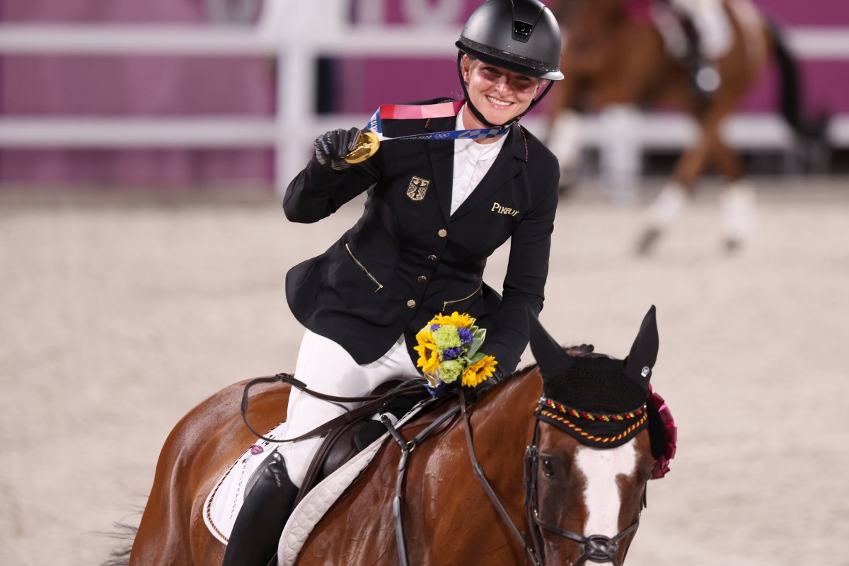 Gold medallist Julia Krajewski from Germany rides a lap of honour on Amande de B`Neville after becoming the first female Olympic eventing champion.