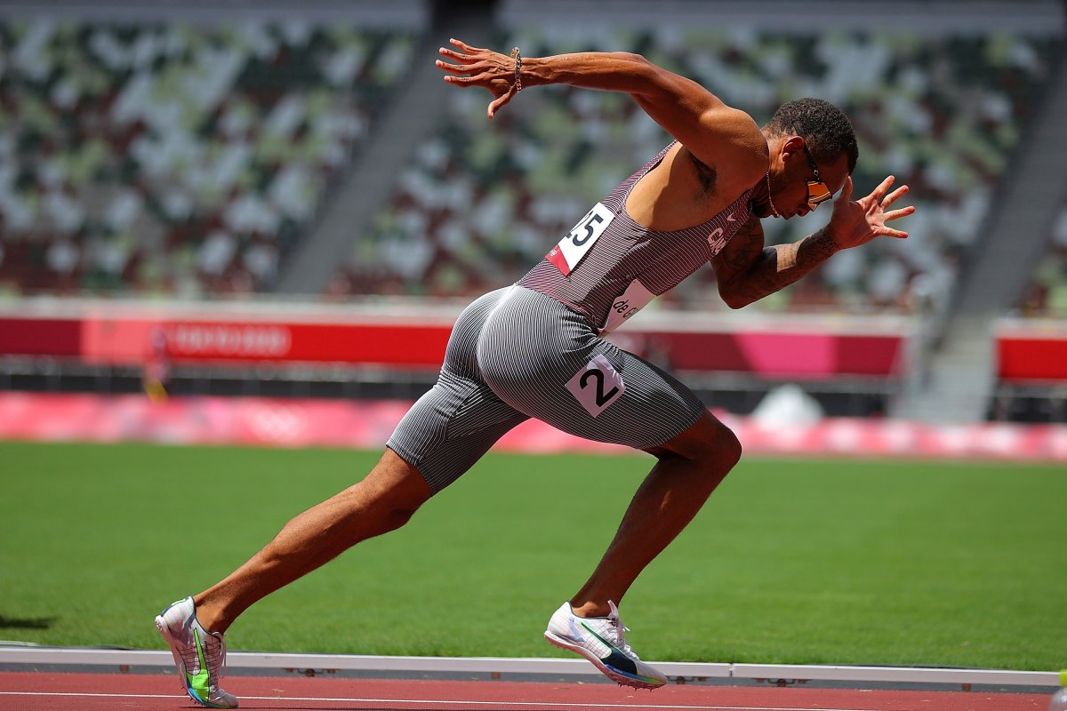 Andre de Grasse of Canada competes during the men's 200m heats at Tokyo 2020 Olympic Games, in Tokyo, Japan, Aug. 3, 2021.