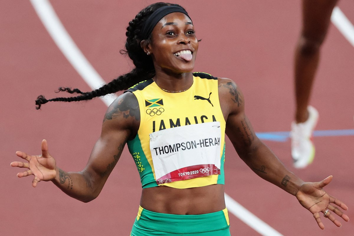 Jamaica's Elaine Thompson-Herah celebrates after winning the women's 200m final during the Tokyo 2020 Olympic Games at the Olympic Stadium in Tokyo on August 3, 2021.