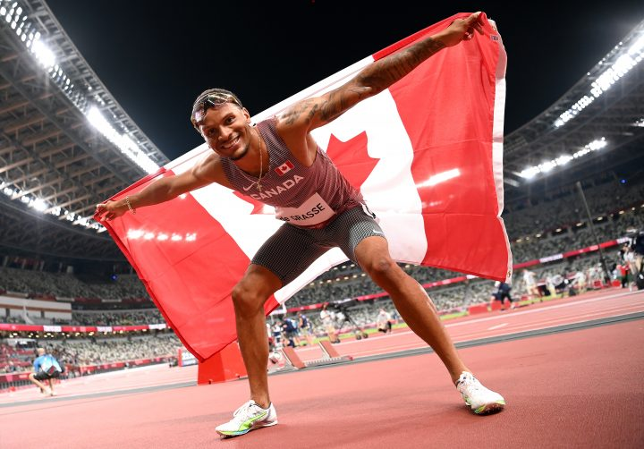 Andre De Grasse of Team Canada celebrates after winning the bronze medal in the Men's 100m Final on day nine of the Tokyo 2020 Olympic Games at Olympic Stadium on August 01, 2021 in Tokyo, Japan.